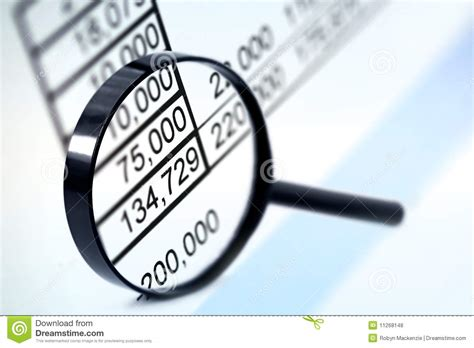 Magnifier over Figures stock photo