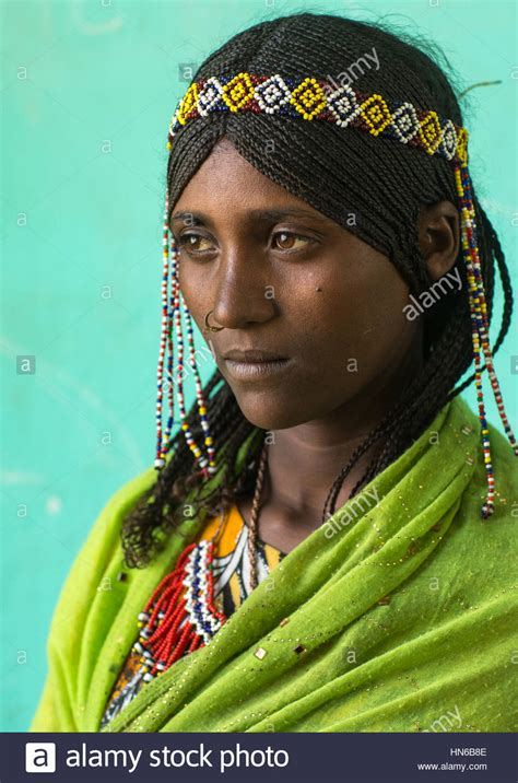 Portrait of an Afar tribe girl with braided hair and nose